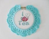 I Love Tea cross stitch in light blue crochet frame