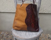 Cowhide tote with snake imprint design