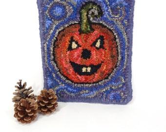 Halloween pumpkin Hand hooked mat Jack O Lantern Wall hanging Primitive rug hooking Autumn decor Orange purple trivet Candle mat