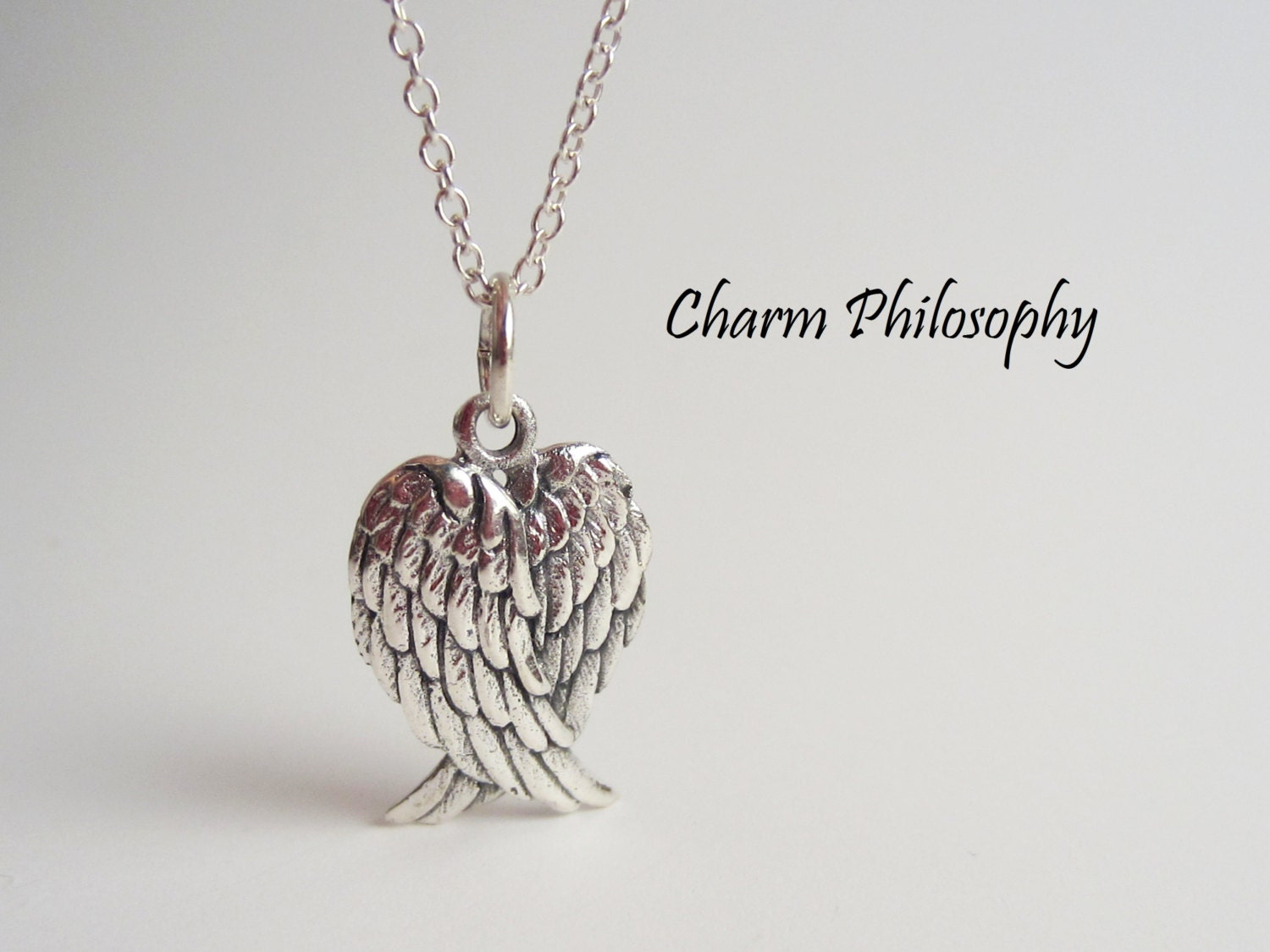 angel wings necklace 925 sterling silver folded wings. Black Bedroom Furniture Sets. Home Design Ideas