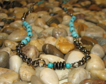 32 inch Gunmetal, Howlite and Turquoise necklace