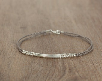 Delicate Bracelet sterling silver tube and sterling silver beads on a delicate silk cord bridesmaid