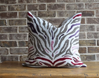 Stunning pink and gray zebra print pillow cover with metallic grey back