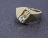 Sliding Diamond in 14K Gold Channel Ring