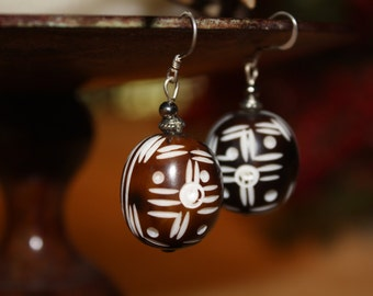 Black and brown carved seed earrings.