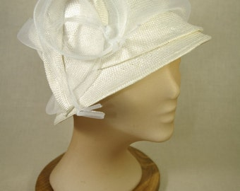 Cloche hat in ivory straw for a bride