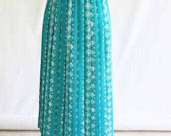 divine turquoise pleated skirt