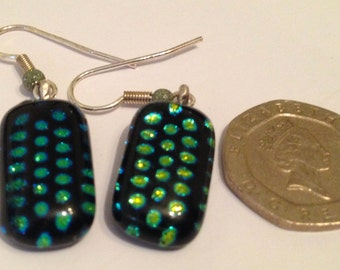 Spotted green and black iridised glass hanging earrings