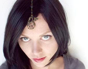 Bronze Dragon Head Jewel with Black Beads