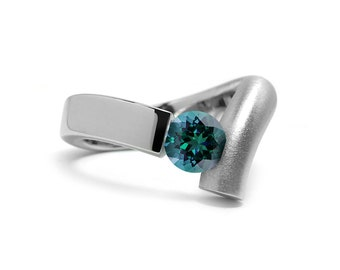 Blue Topaz Ring Different and Unusual Tension Set  in Two Tone Stainless Steel