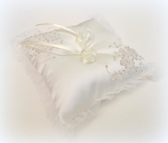 Ivory wedding ring pillow. Silk satin ring bearer. Ivory lace flowers decorated with swarovski crystals and ivory pearls.