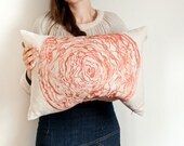 Cabbage pillow in coral-orange watercolor printed on soft cotton linen