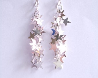 Star earring silver. Long dangle with tiny sparkling stars on chain. Earstuds or Leverbacks