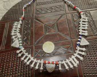 Necklace made of antique silver fertility symbols of Ethiopia and Protective charms, colred in with antigue bohemian glass beads.