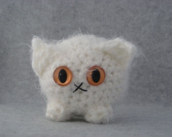 Crocheted white plush kitty