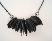 Many petals of recycled inner tube rubber necklace