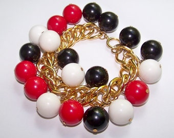 SJK VINTAGE -- Black Red and White Plastic Baubles Bracelet with Chunky Gold Tone Chain (1960's-70's)