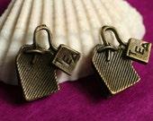 Closeout Antique brass tea time charm 15x15mm, 12 pcs (item ID YDTEAD)