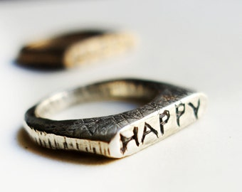 Hand carved Happy Rings in Sterling Silver