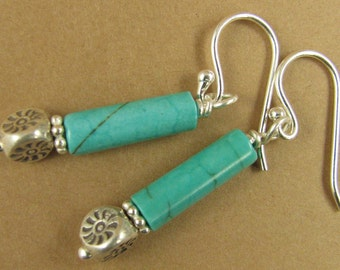 Long turquoise tube and silver drop earrings. Fine and sterling silver.