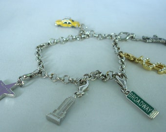 American & New York Sights charm bracelet - Dollar - Walk of Fame - Broadway, Statue of Liberty, Yellow Cab, Empire State Building