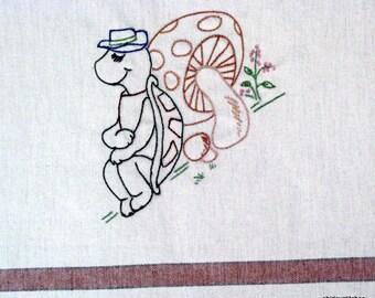 Tea Towel-Hand embroidered-myrtle turtle taking a break.