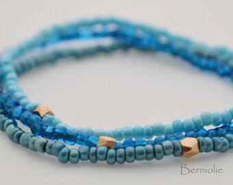 Beaded bracelet, blue shades, glass seedbeads, stretchy, 7 inch, S2