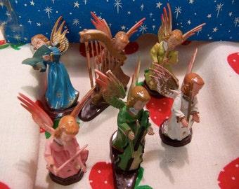 six dancing angel musicians