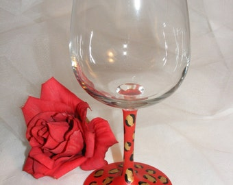 painted wine glass in red leopard or cheetah  - perfect for the birthday girl