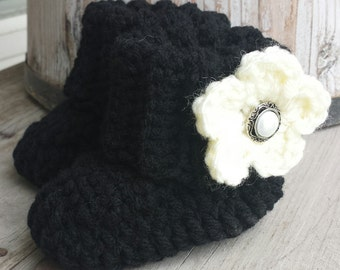 Crochet baby girl boots, in black with cream flower and pearl button center. size 0 to 3 mo.
