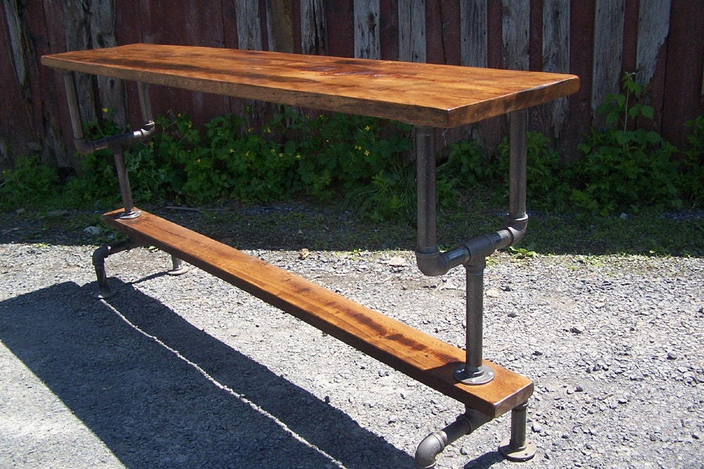 Industrial Style Bar Height Table With A Metal Pipe Base And