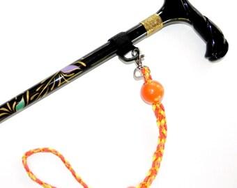 Cane Strap or Umbrella Strap Orange Cane Catcher, Orange and Yellow Cording, Orange Round Fixed Bead, Smaller Moveable Bead on Strap    CC7