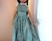 A vintage hand carved hand painted wooden doll