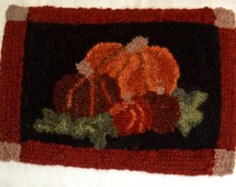 Pumpkin hooked rug