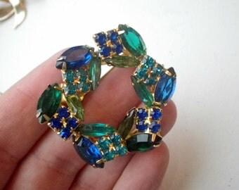 Striking Faceted Blue/Green Rhinestone Circle Pin