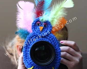 Camera lens buddy. Crochet  lens critter peacock. Photographer helper