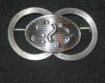 Beau Sterling Silver vintage buckle or rings around modern earth globe Brooch