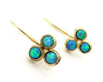 Opal earrings set in gold 3 gemstones