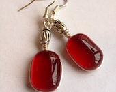 Ruby red glass earrings hand made.