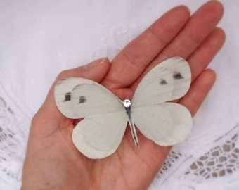 Brides Soft White silk butterfly hair clip with Crystal detail. Perfect for weddings!
