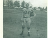 High School Football Player Standing in Uniform Holding Helmet 1950s 60s Boy Vintage Black and White Photo Photograph