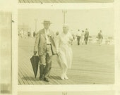 Old Husband Wife Holding Hands Walking Down the Boardwalk Beach Arcade Series Pictures 1920s Love Black and White Photo Photograph