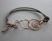 Brown leather copper bracelet with a swirl and swan hook clasp - Leather bracelet - Copper bracelet
