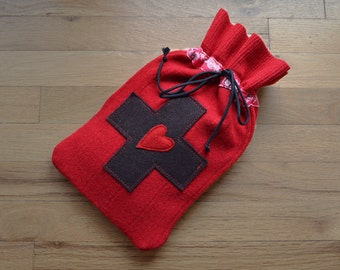 Hot water bottle cover in red felted wool with red and white hearts
