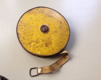 Vintage yellow tape measure 100 feet