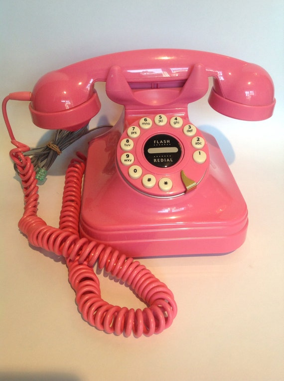 Vintage hot pink push button phone.  Retro telephone.