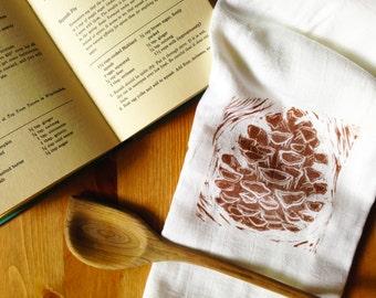 wood block print pinecone tea towel by color.joy