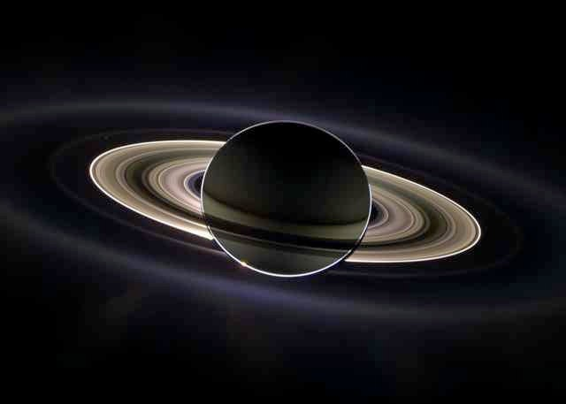 Weird Space Photo Saturn Eclipse Rings Backlit by Sun Behind