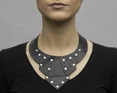 Deco-inspired collar / choker: upcycled black rubber innertube with rivet details.