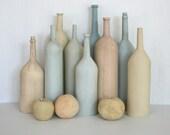 Mundane. Ceramic still life with bottles and fruit. Blue, tan, yellow, natural, neutral, pastel, rustic, beach decor, modern.